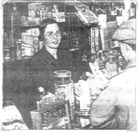 Edith working in the chemist's shop